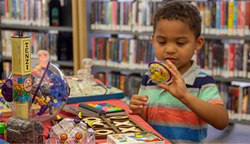 Child at library doing craft project