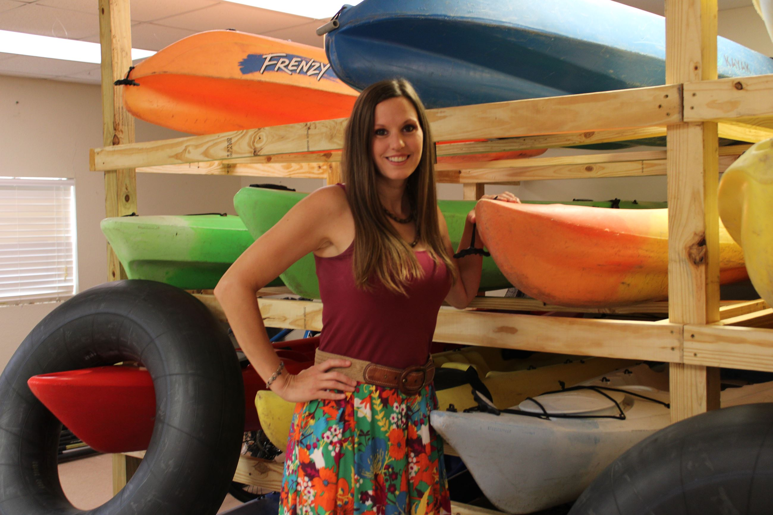 Ashley Magee poses with kayaks