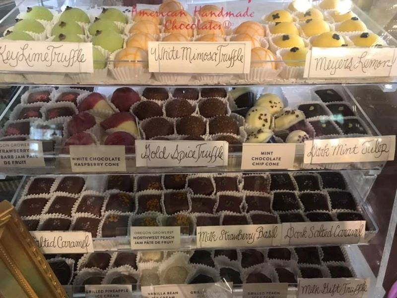 A display case of a variety of handmade chocolates