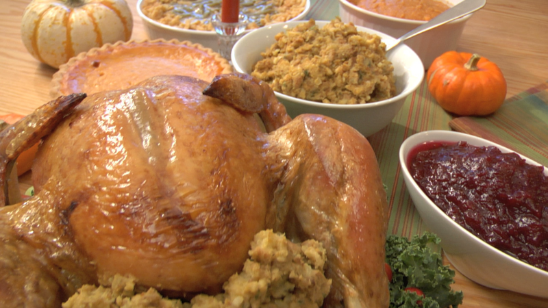 Thanksgiving meal with turkey, stuffing and traditional sides.