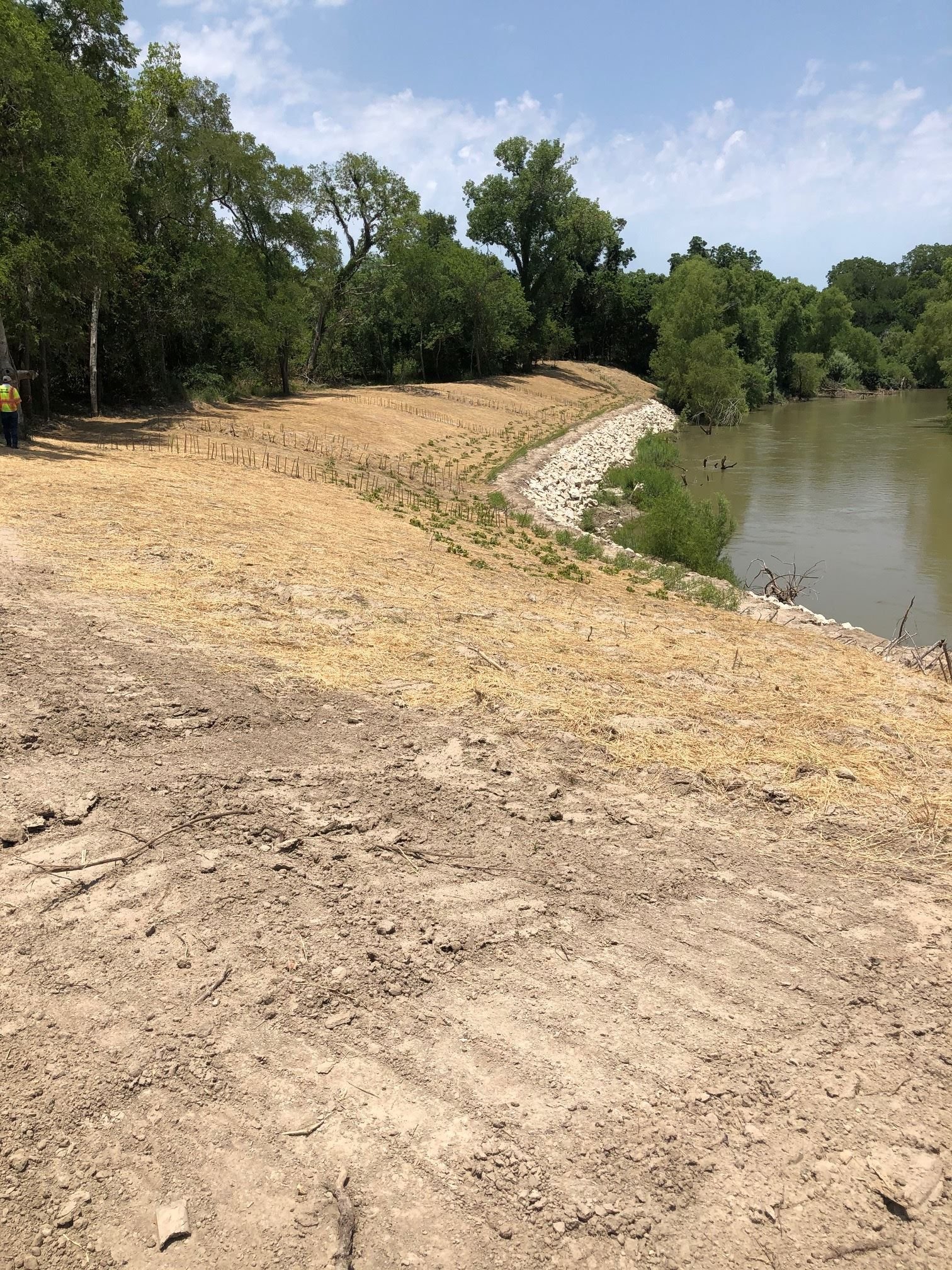 Guadalupe River bank shored up using stones