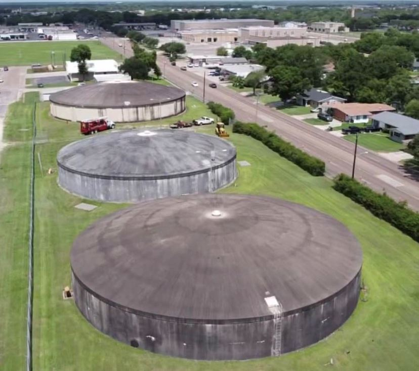 Dark-colored water tanks