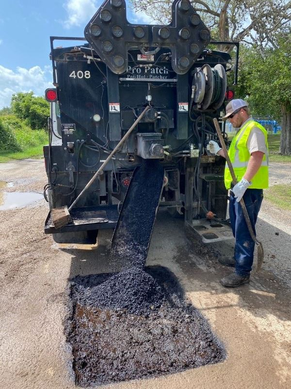 James Toth repairs a pothole using one of the City of Victoria's patch trucks.